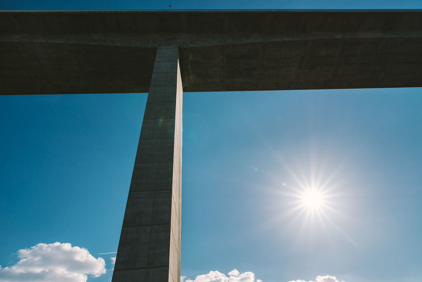 Connected Architecture Blue Bridge - Man Made Structure Built Structure Clear Sky Connection Day Highway Lens Flare Low Angle View Minimal Sky Sunlight