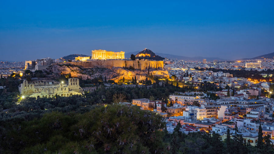 view on Acropolis during sunset, Athensa Athens, Greece Acropolis Architecture Athens Blue Building Building Exterior Built Structure City Cityscape Dusk Greece High Angle View History Illuminated Nature No People Outdoors Plant Residential District Sky The Past Travel Destinations Tree