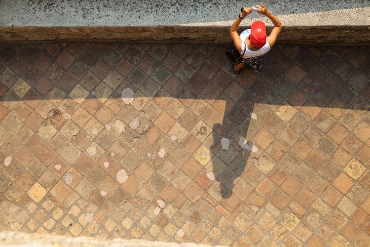 Woman walking on cobblestone street