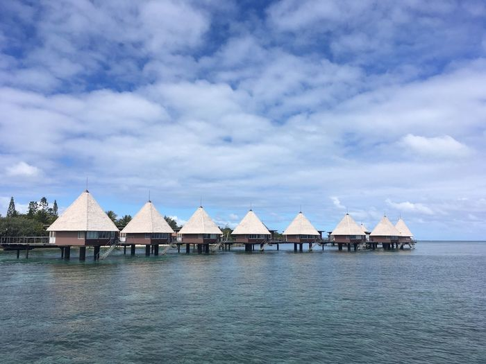 Water bungalows in New Caledonia Maitre Melanesia Oceania New Caledonia Water Bungalows Architecture Built Structure Sky Cloud - Sky Water House Building Waterfront No People Tranquility Beauty In Nature Roof Tranquil Scene Nature Residential District Scenics - Nature Sea Outdoors