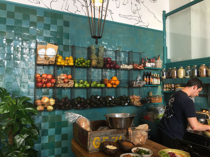 Man prepares an order at a stylish London cafe. Breakfast Lunch Stylish Wait Architecture Cafe City Day Editorial  Food Food Preparation Fresh Fruit Healthy Eating Hipster Indoors  Men Occupation One Person Organic Organic Food People Restaurant Small Business Working