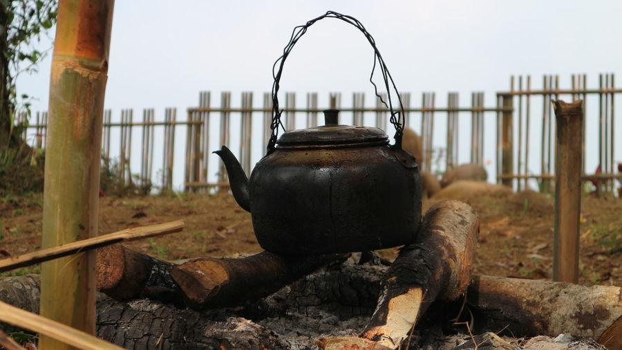 Tea kettle over bonfire