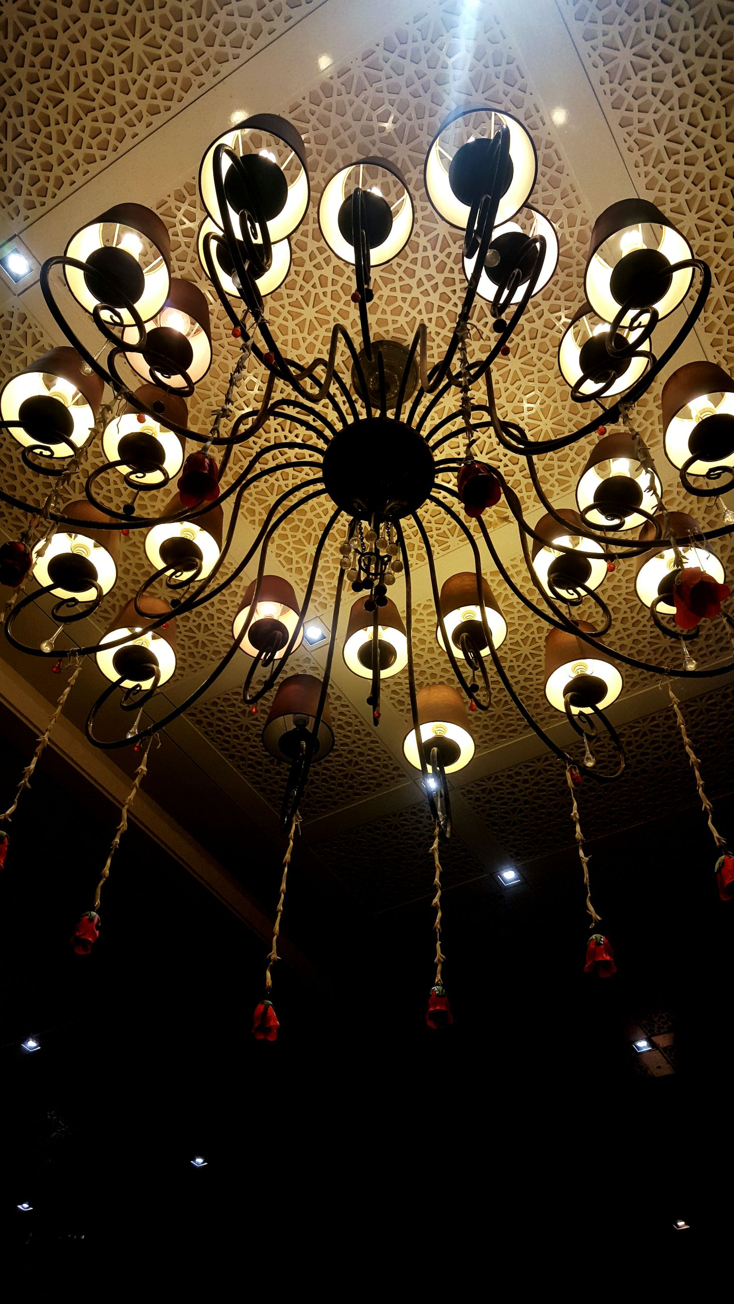 low angle view, lighting equipment, electricity, hanging, chandelier, ceiling, illuminated, no people, indoors, light bulb, luxury, close-up