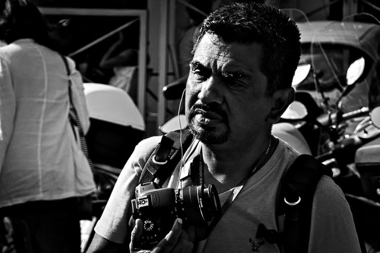 Contemplation. Black And White Black People Candid Candid Photography Candid Portraits City Life Front View Gear Holding Monochrome Photography Outdoors Person Photographer Photographic Equipment Rome Tourist Stories From The City Inner Power This Is My Skin This Is Natural Beauty