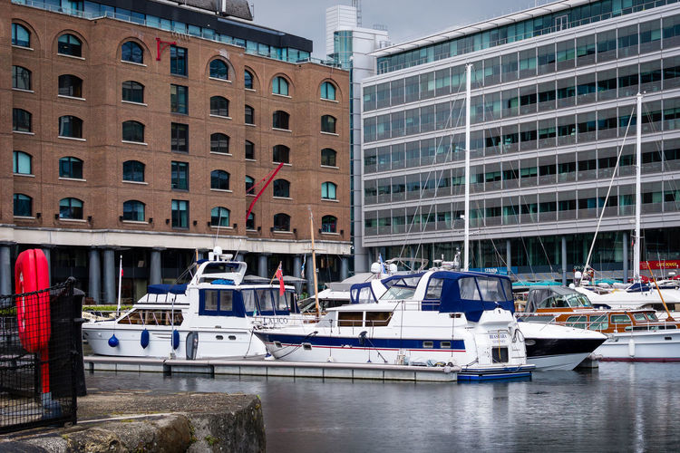 Nautical Vessel Building Exterior Mode Of Transportation Architecture Transportation Built Structure Moored Building Water City Day Waterfront Harbor No People Nature Travel Outdoors Reflection Yacht Canal Luxury Sailboat Passenger Craft Office Building Exterior St Katherine's Dock London Dock Buildings Pattern