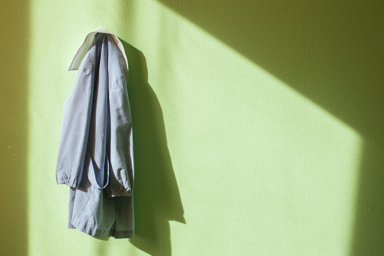 Close-up of clothes hanging on wall