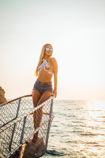 Young Adult Fashion Sea Young Women Sunglasses One Person Leisure Activity Water Glasses Long Hair Three Quarter Length Bikini Clothing Lifestyles Sky Hair Swimwear Real People Hairstyle Horizon Over Water Beautiful Woman Outdoors