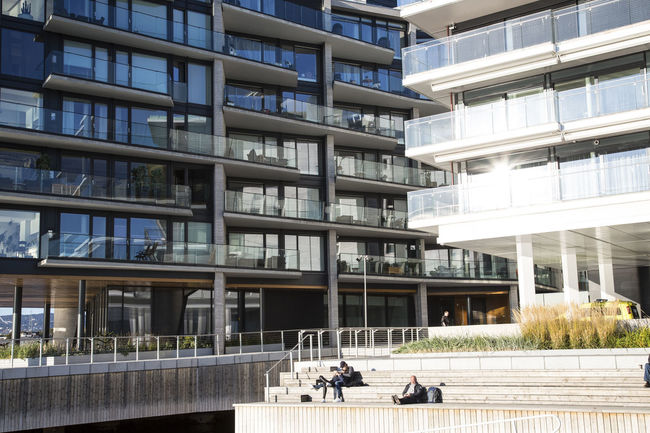 Apartment Architecture Building Building Exterior Building Story Built Structure City City Life Day Geometric Shape Glass - Material Low Angle View Modern Office Building Oslo Oslo, Norway Outdoors Person Reflection Window