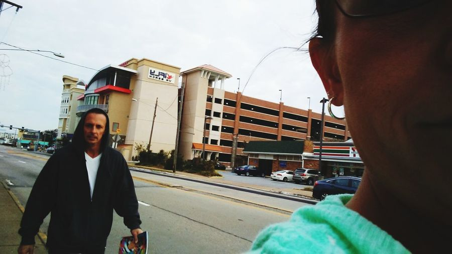 a selfie with my hubby while walking to Virginia Beach, just coming from IFly & mastering it! IFly FamilyVacay Va Beach Here I Come Walkingselfie EyeEm2018selfie EyeEm Selects City Portrait Looking At Camera Standing Business Finance And Industry Sky Building Road Marking Empty Road