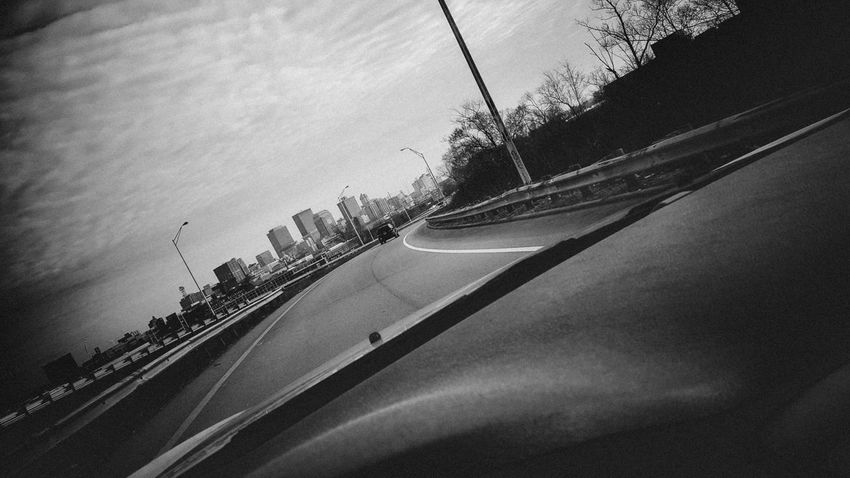 Black & White Black And White City City Life City Skyline City View  Dashcam Driving Head Out On The Highway Highway On The Move On-ramp Railing Skyline View Of The City Road Looking For Adventures