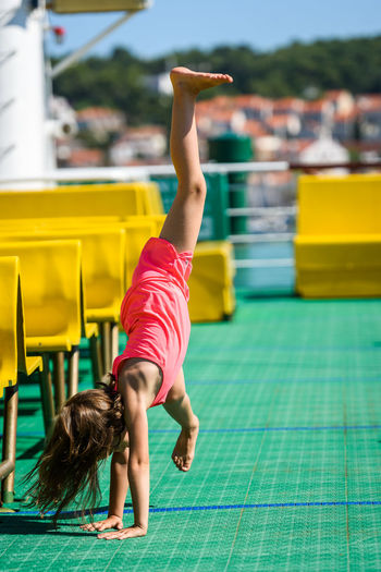 Girl doing stunt in boat