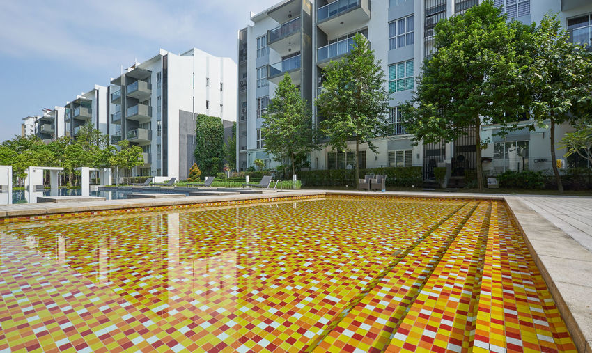 Architecture Building Building Exterior Built Structure City Day Footpath Grass Growth Modern Multi Colored Nature No People Office Building Exterior Outdoors Pattern Plant Sky Street Tree Water