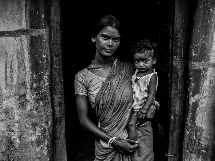Pleased or Perplexed - A single mother fighting the odds of hard life. Taken at a rural village in West Bengal Bengal Debarshi Mukherjee Photography Documentary Photography Environmental Portraits Family India Life Rural Traditions Blackandwhite Debarshimukherjee Emotion Lifestyles Mood People Portrait This Is Family Togetherness Village Women Visual Creativity Focus On The Story EyeEmNewHere The Portraitist - 2018 EyeEm Awards