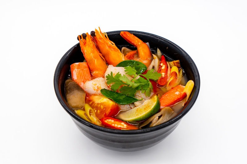 Close-up of food in bowl against white background