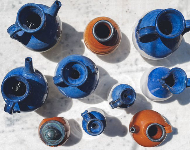 Ceramic Jars Jars Of Clay Art And Craft Art And Craft Equipment Blue Ceramics Choice Circle Clay Close-up Day Directly Above Geometric Shape Group Of Objects High Angle View Indoors  Large Group Of Objects Multi Colored Shape Still Life Sunlight Table Variation