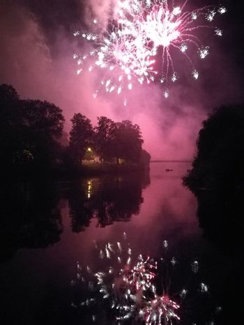 Night Reflection Firework Display Exploding Celebration Arts Culture And Entertainment Event Multi Colored Sky Firework - Man Made Object Star - Space Awe Water No People Outdoors Illuminated Lake Tree Cityscape City Fireworksphotography Silhouette Tree HUAWEI Photo Award: After Dark