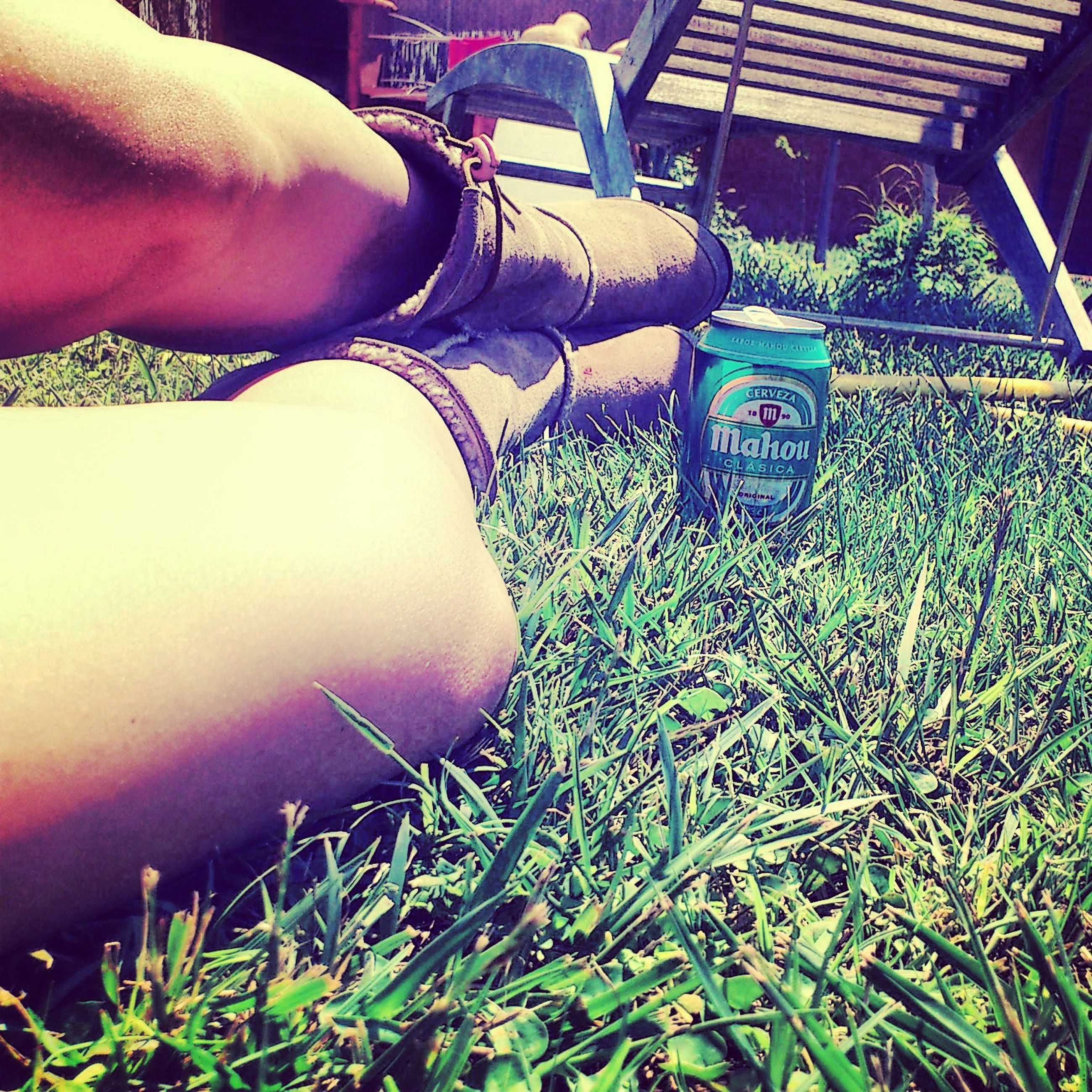 grass, high angle view, field, relaxation, low section, front or back yard, day, part of, lifestyles, outdoors, sitting, grassy, plant, sunlight, chair, person, leisure activity, cropped