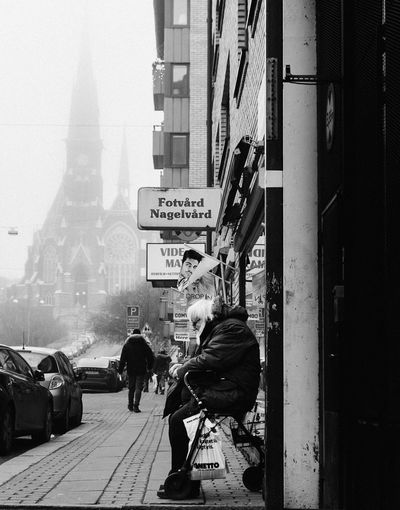 Black And White Friday Gothenburg, Sweden Architecture Streetphotography Misty Morning Fog Foggy Morning Foggy Blackandwhite Black & White Bnw_collection Bnw_captures Everybodystreet Bnw Street Photography Real People Building Exterior City Street