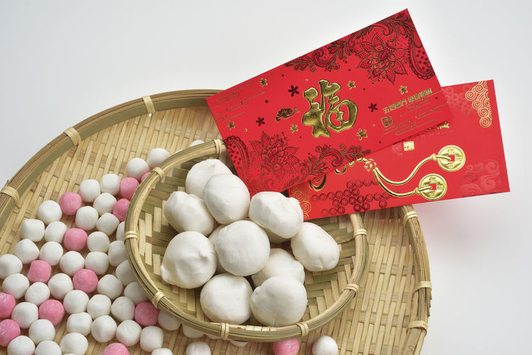 In the seasonal changes of the Winter Solstice and the Lantern Festival, Taiwanese people make glutinous rice balls, indicating that their families reunite. Lantern Reunion  Taiwan Taiwanese Cuisines Basket Close-up Day Festival Food Freshness Lantern Festival No People Red Rice Dumpling Successful White Background Winter Solstice
