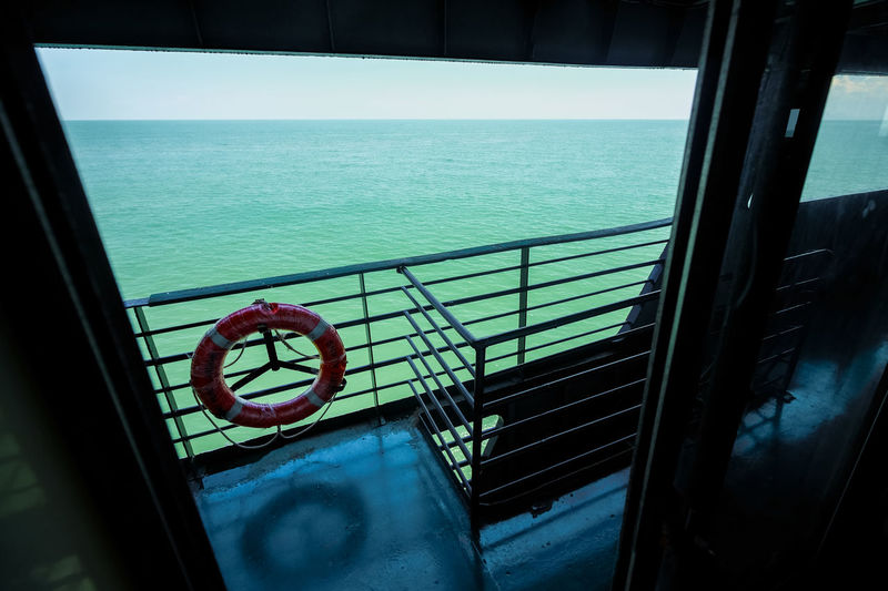 Water Sea Railing Transportation Mode Of Transportation Nautical Vessel Nature Horizon Over Water No People Sky Horizon Vehicle Interior Architecture Outdoors Blue Passenger Craft Ferry Boat On The Way Water Travel Travel By Sea Travel Safety First