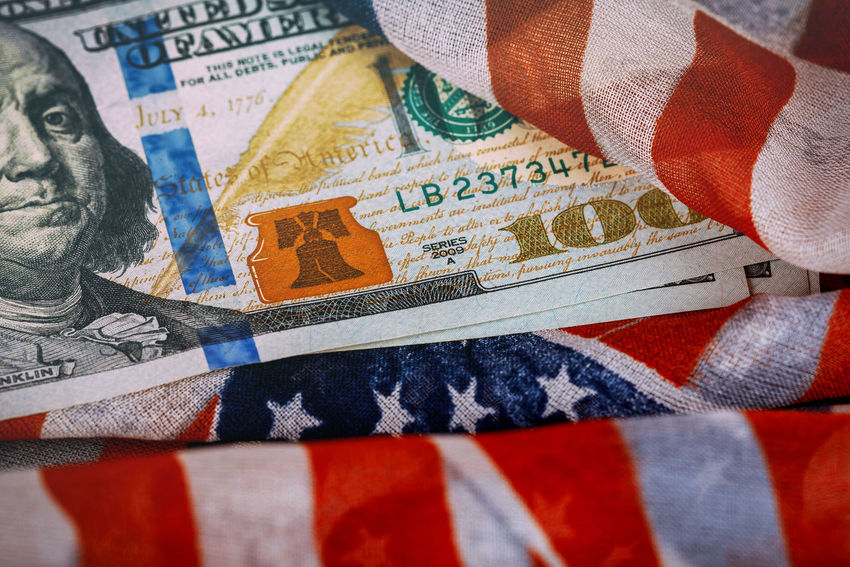 American flag on assorted banknotes of US paper currency American American Flag Dollar Sign HUNDRED United States American Culture Cash Close-up Dollar Dollars, Money Economic Exchange Finance Financial Flag Paper Currency Patriotism Savings Savings Money Us Paper Currency Wealth