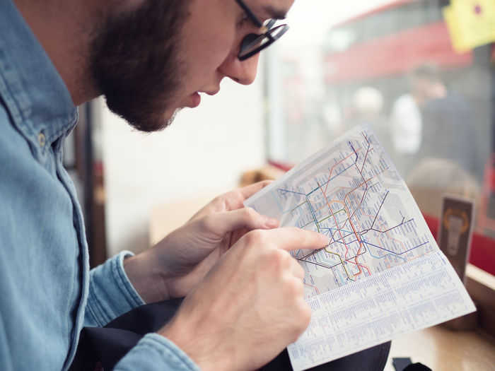 Close-up of man pointing at route map