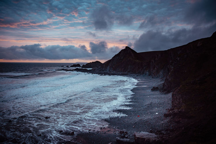 Sunset on english coastline in quay.