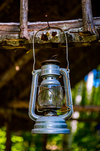 Low angle view of electric lamp hanging on ceiling