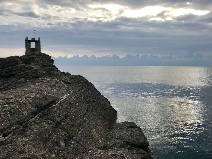 Punta Chiappa Cloud - Sky Sky Sea Water Rock Rock - Object Beauty In Nature Built Structure Solid Tranquility Tranquil Scene Lighthouse Land No People Tower Architecture Building Exterior Scenics - Nature Guidance Nature EyeEmNewHere