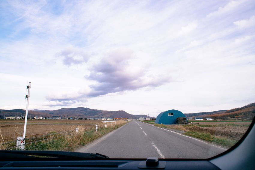 Farmland under cloudy sky out of car window. Transportation Sky Car Cloud - Sky Road The Way Forward Car Point Of View Road Trip Outdoors Travel Photography Travel Japan Hokkaido Obihiro Furano Driving Drive