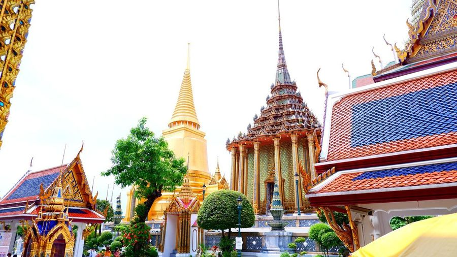 Low angle view of pagoda against buildings