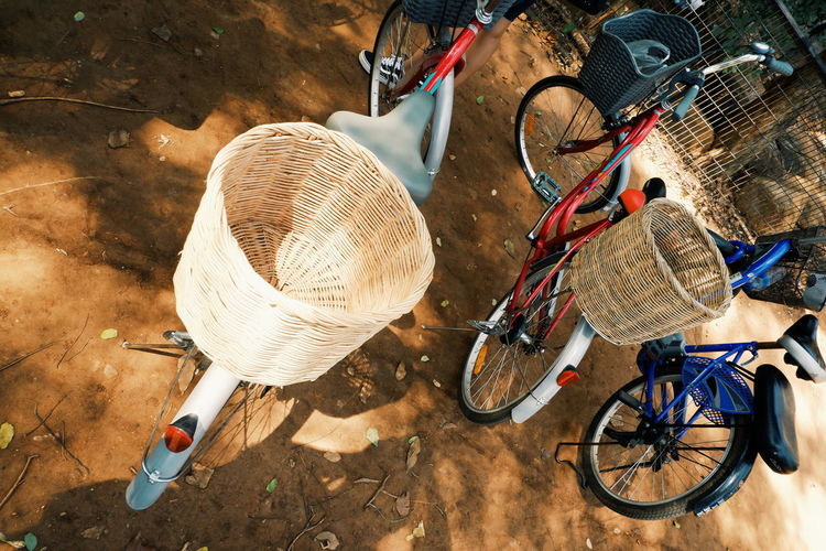 Transportation Land Vehicle Mode Of Transportation Bicycle Basket Container Day Bicycle Basket Outdoors Street City High Angle View No People Stationary Road Parking Nature Motorcycle Wheel