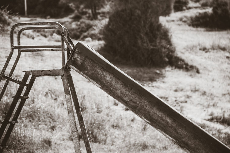 Apocalypse Playground Equipment Abandoned Absence Day Empty Field Focus On Foreground Grass Ladder Land Metal Nature No People Old Outdoor Play Equipment Outdoors Park Park - Man Made Space Plant Playground Sepia Wheel