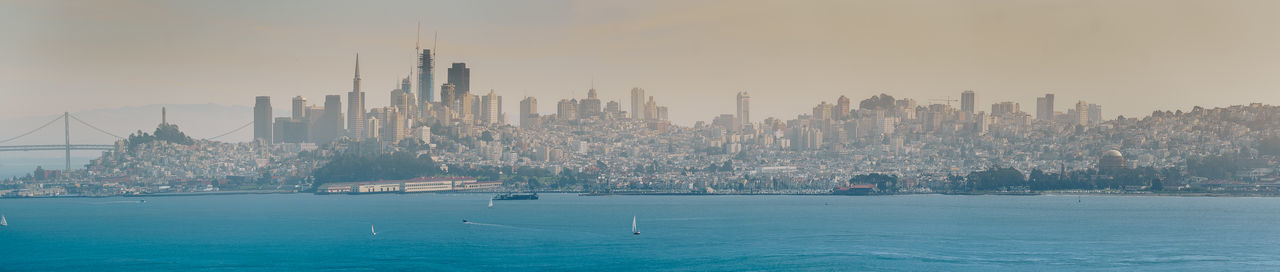 Panoramic View Of Bay Against Modern Buildings In City