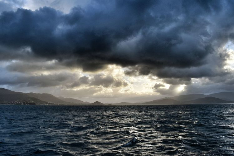 Cloud - Sky Sky Sea Water Scenics - Nature Beauty In Nature Tranquil Scene Tranquility Nature No People Storm Waterfront Overcast Dramatic Sky Storm Cloud Mountain Outdoors Sunset Ominous Power In Nature