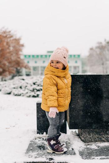 Full length of girl standing on snow