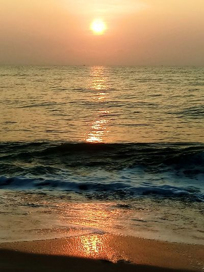 Sea Water Sunrise Over Sea Scenics - Nature Beauty In Nature Sky Horizon Horizon Over Water Land Beach Wave Motion Orange Color Tranquil Scene Reflection Sun No People Outdoors