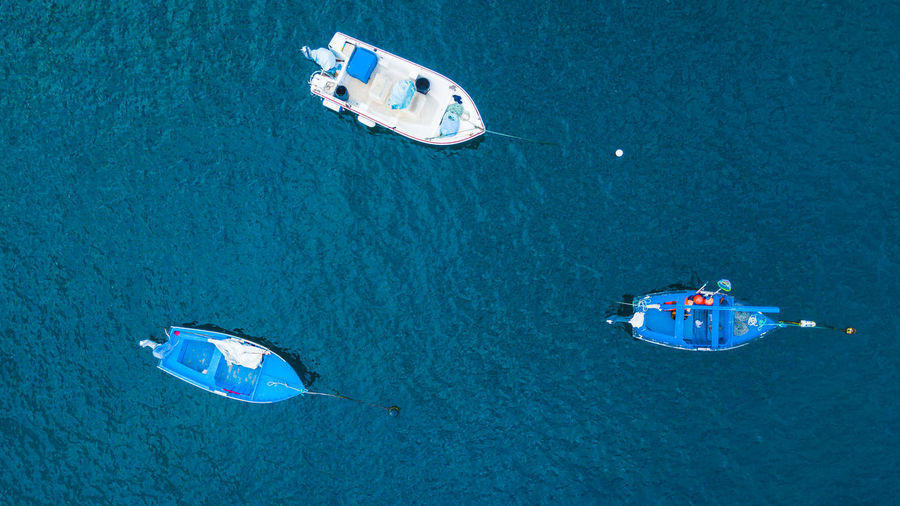 A top view of a three fishing boat. Blue Ocean Transportation Above Aerial View Daylight Drone Photography Fisherman Fishing Fishing Boat Fishing Industry High Angle View Marine Nautical Vessel Ocean Outdoors Sailing Sailing Boat Sea Sea Life Top Perspective Top View