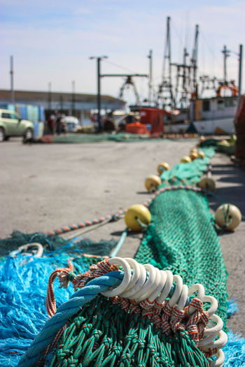 Beach Boat Buoy Close-up Day Fishing Equipment Fishing Industry Fishing Net Fishing Tackle Focus On Foreground Harbor Moored Nautical Vessel No People Outdoors Rope Sky Transportation Water