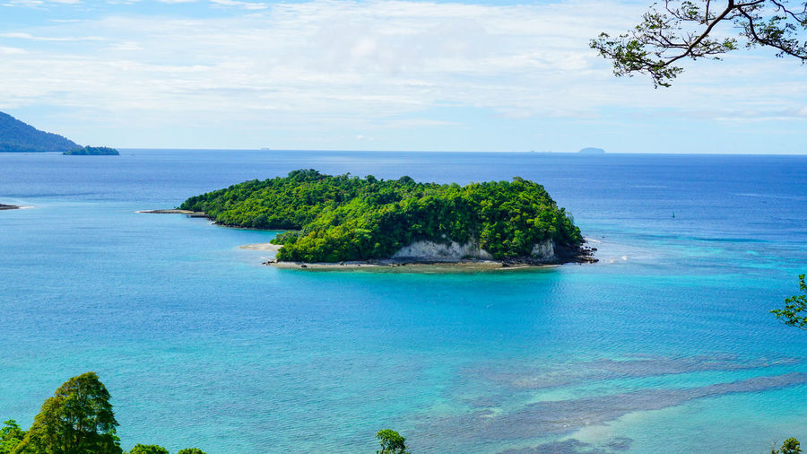 An Island at Sabang Island Indonesia with clear blue water Aceh Aceh, Indonesia INDONESIA Acheh Beauty In Nature Blue Cliff Day Horizon Over Water Idyllic Nature No People Outdoors Rock - Object Sabah Sabang Island Sabangisland Scenics Sea Sky Tranquil Scene Tranquility Tree Water