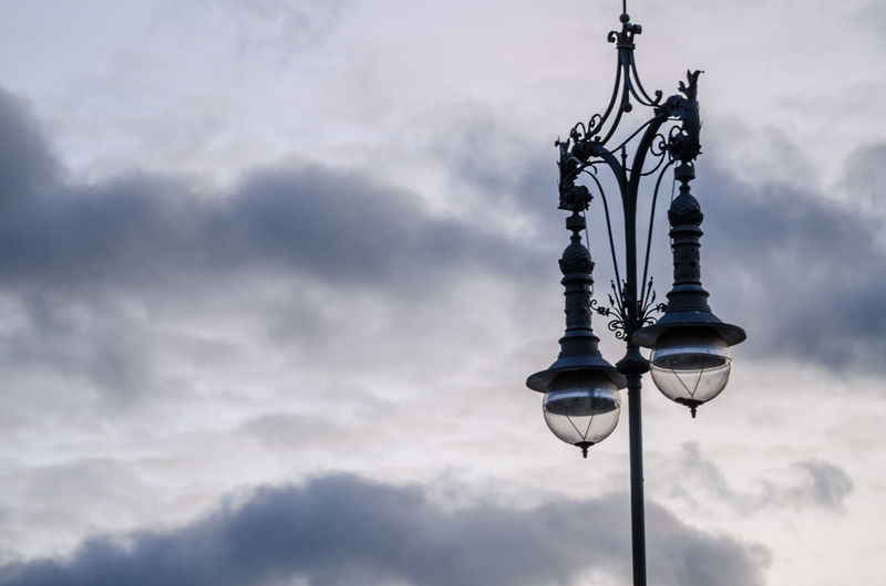 Low Angle View Of Street Lamp Against Cloudy Sky