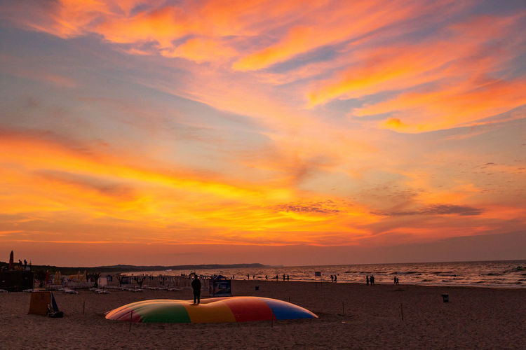 Baltic Sea Architecture Beach Beauty In Nature Built Structure Cloud - Sky Idyllic Incidental People Land Nature Orange Color Outdoors Sand Scenics - Nature Sea Sky Sunset Tranquil Scene Tranquility Water