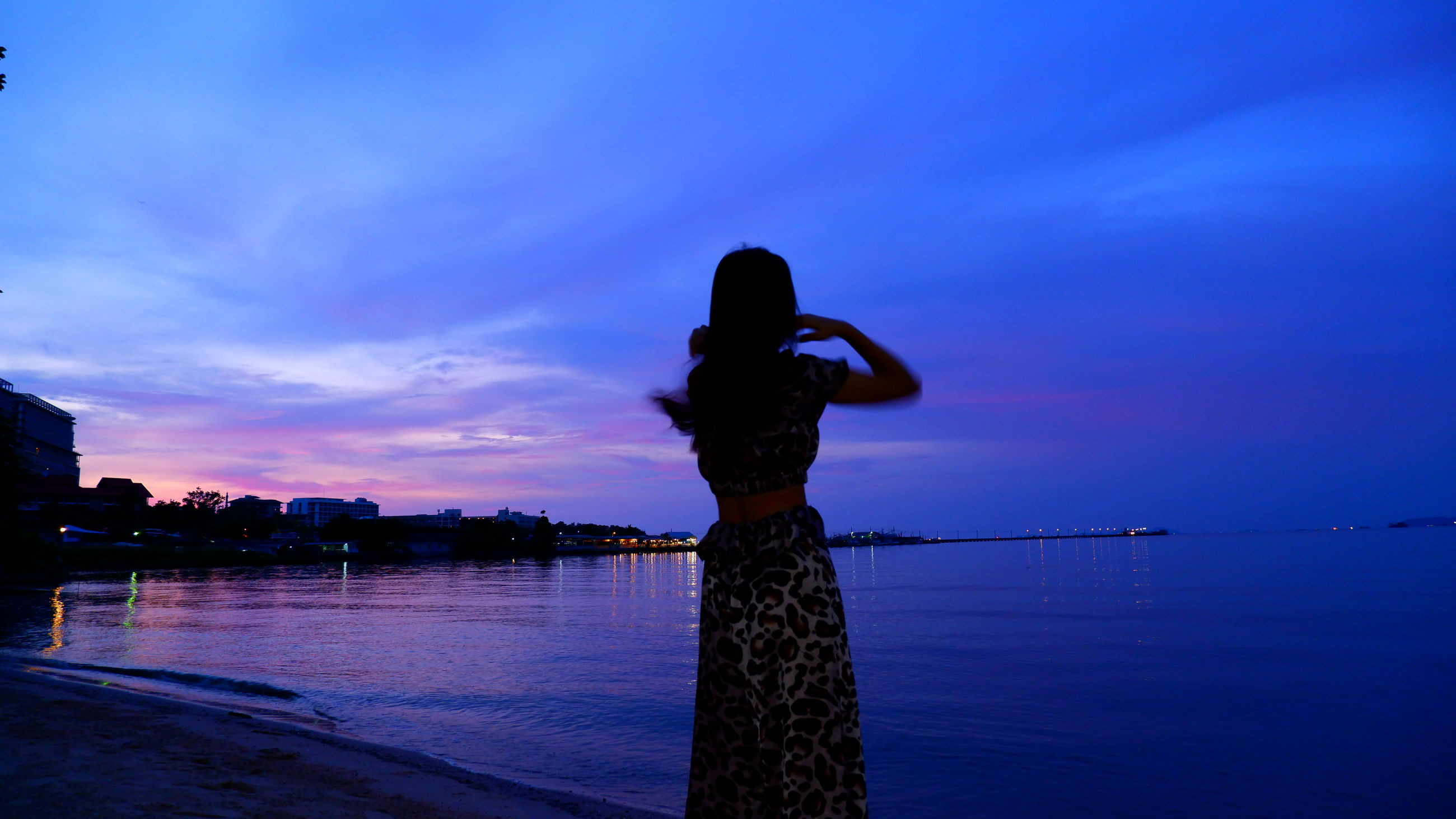 sky, water, reflection, one person, evening, blue, dusk, sunset, nature, horizon, silhouette, cloud, sea, adult, beauty in nature, women, standing, darkness, outdoors, tranquility, scenics - nature, architecture, lifestyles, beach, land, sunlight, ocean, tranquil scene