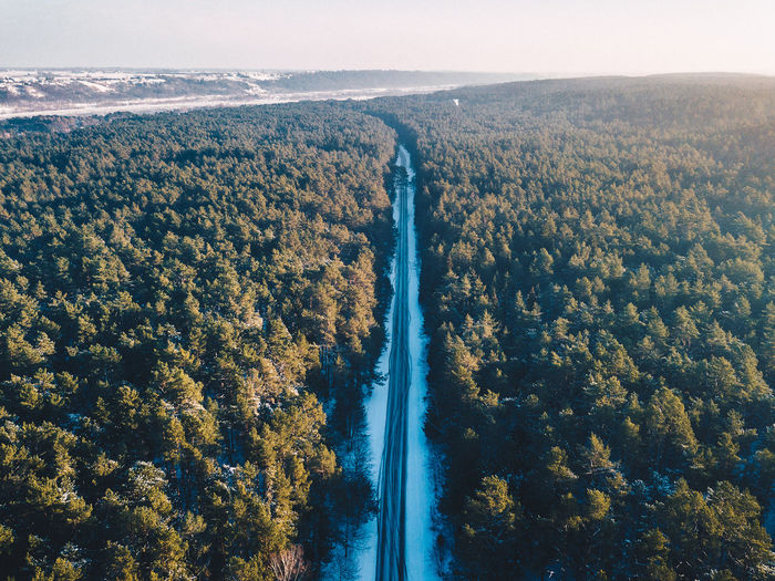High angle view of river by trees against sky