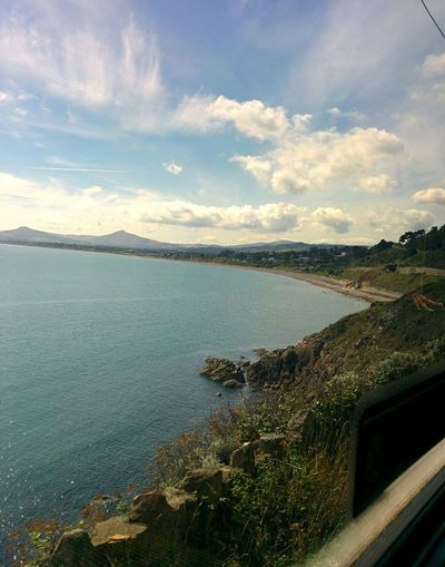 Taken from train. Water Scenics Cloud - Sky Landscape Outdoors Sky Nature Beauty In Nature Day Coast Sea Summer Amazing View Beautiful No Edit/no Filter Nofilter Dublin, Ireland Dublin City Clouds Tranquility Tranquil Scene Ocean Ocean View Sea And Sky