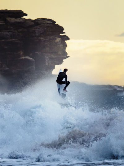 Giddyup Beauty In Nature Leisure Activity Motion Rock Formation Sea Surfing Water Wave