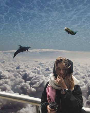 Collage Art Dolphins Editing Sightseeing Travel Animal Themes Clouds Day Digital Art Leisure Activity Lifestyles Nature One Person Outdoors People Photo Manipulation Real People Sea Sky Surrealism Surrealist Art Warm Clothing Water Young Adult Young Women