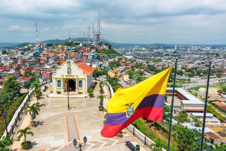 Ecuadorean flag waving against church in city