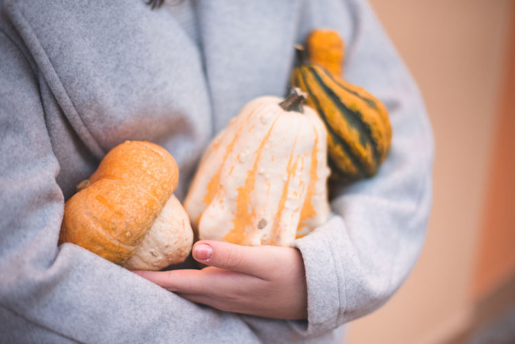Autumn Mood Food And Drink Food One Person Holding Midsection Human Hand Hand Freshness Human Body Part Close-up Wellbeing Casual Clothing Vegetable Adult Towel Healthy Eating Indoors  Focus On Foreground Day Snack
