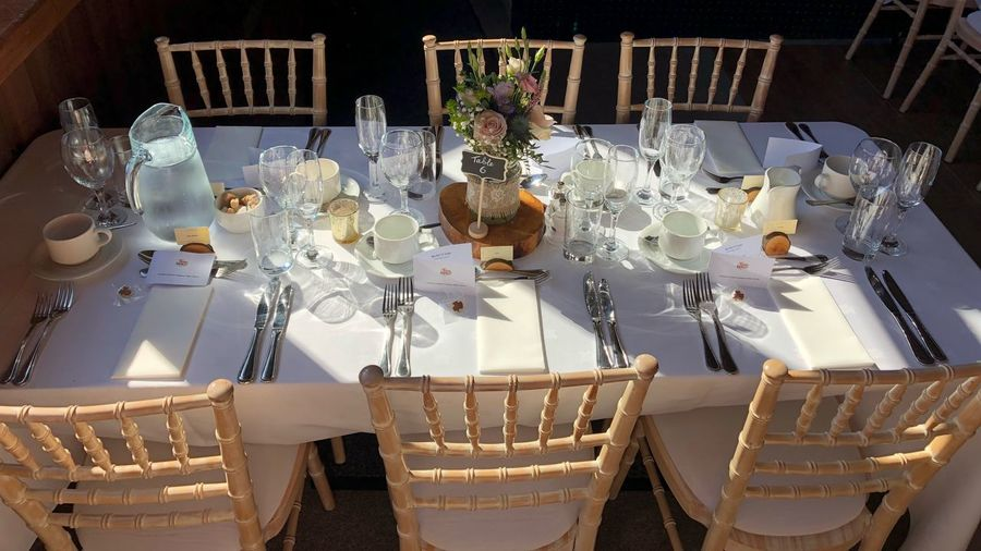 Wedding table Six Celebration Dining Cutlery Centrepiece Place Setting Table And Chairs Chairs Table Wedding Wedding Day Decoration Table No People Celebration Indoors  Large Group Of Objects Christmas Arrangement Food And Drink